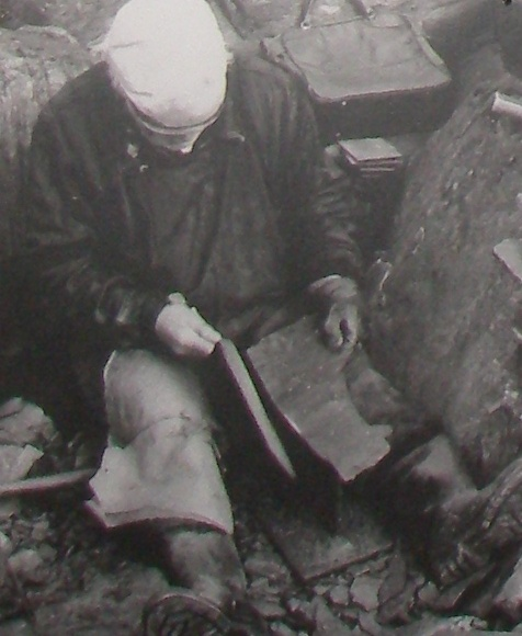 Donny May from Luing demonstrating how to split slate, 1980